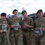 Army cadets hold brochures